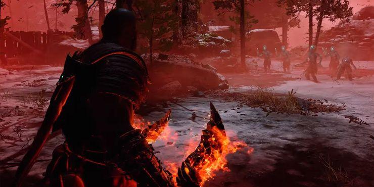 Kratos władający Ostrzami Chaosu.